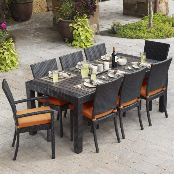 outdoor patio dining sets RST Brands Deco 9-Piece Brown Wood Frame Wicker Patio
