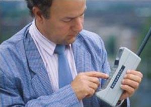 moto Motorola Posts Q2 Profits, Sales Cut in Half
