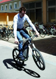 120514-audi3-212x300 2.3kW Carbon Fiber Electric Bike from Audi Boasts 'Wheelie Modes', WiFi