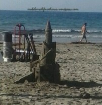 A lady and a small child were out making these. Imagine that this is the sand castle you just pop out for fun. Talent1
