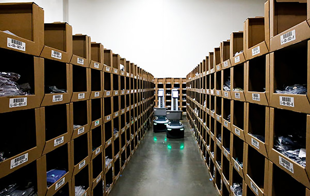Locus robot in warehouse aisle