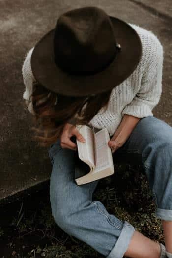 Girl sitting outside in yard doing Bible Study