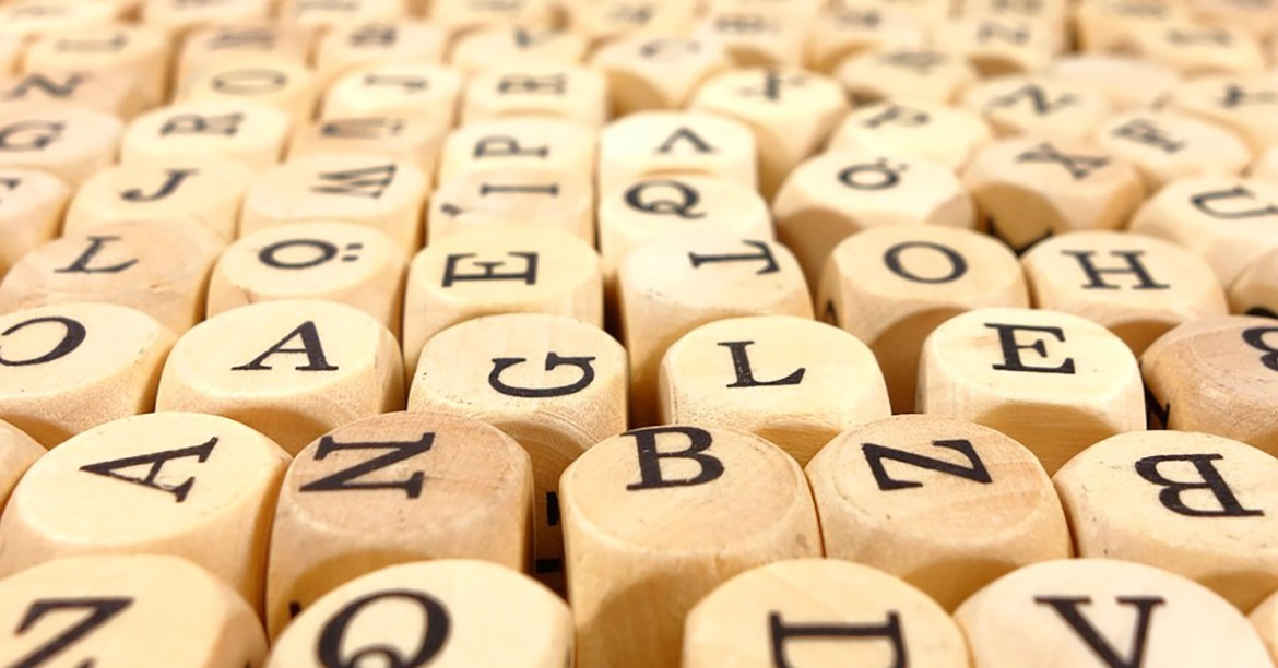 lots of wood cubes with black letters
