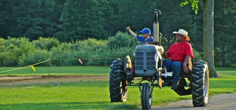 Two people on a tractor