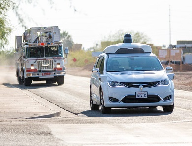 Waymo car and emergency vehicles