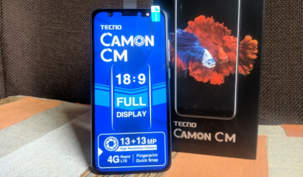 tecno camon cm review -standing with box