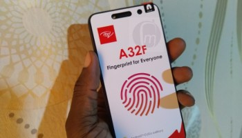 itel A32F Unboxing phone in hand