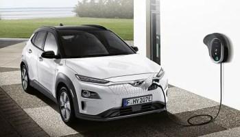 Hyundai Kona electric car and charging station