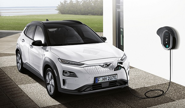 Hyundai Kona electric car and charging station