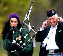 sexy-chick-playing-the-bagpipes-and-some-old-dude_small
