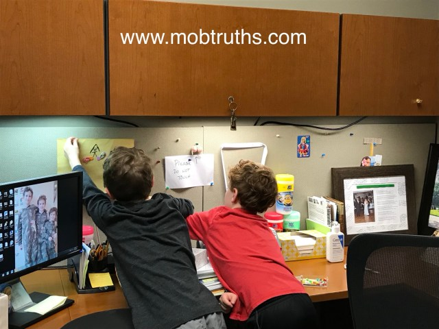 Working moms -- the boys help me decorate my new office