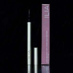 Ilia liquid liner and box on black background