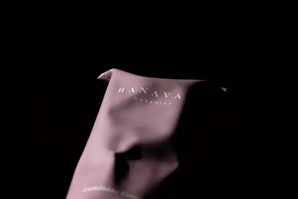 Women-owned beauty brand Ranavat pink aluminum creamy cleanser tube on black background