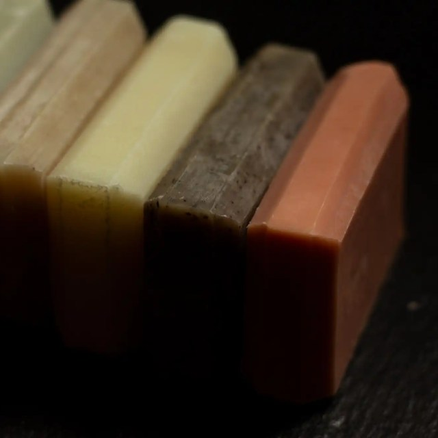 Organic Bath Co. five different colored bar soaps in a row