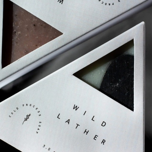Wild Lather white triangle shaped soaps on a black background