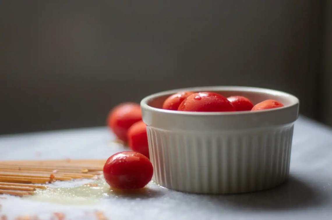 Adobe Lightroom photography no edit: grape tomatoes in white ramekin on marble board