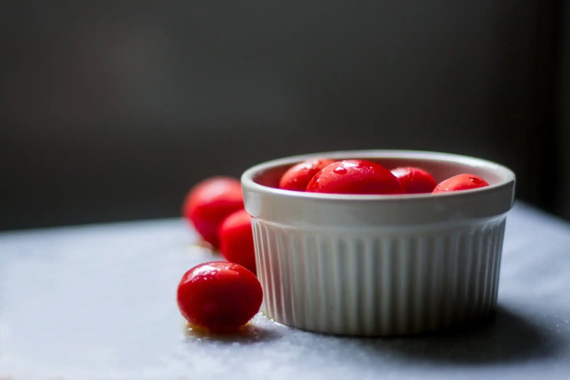Adobe Photoshop photography edit: tomatoes in white ramekin with pasta edited out with Photoshop