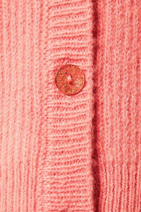 Foto del punto y botones transparentes con brillos de la chaqueta Nora de Soaked.