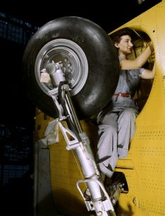 "This woman worker at the Vultee-Nashville is shown making final adjustments in the wheel well of an inner wing before the installation of the landing gear, Nashville, Tenn. in February 1943.  This is one of the numerous assembly operations in connection with the mass production of Vultee ""Vengeance"" dive bombers. (Alfred T. Palmer/U.S. Office of War Information/Library of Congress)"