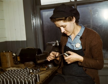 War production workers at the Vilter [Manufacturing] Company making M5 and M7 guns for the U.S. Army, Milwaukee, Wis. in February 1943. Ex-housewife, age 24, filing small parts. Her husband and brother are in the armed service. (Howard R. Hollem/U.S. Office of War Information/Library of Congress)