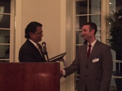 Dr. Raman presents outgoing president, Dr. Mac Darnall, with a certificate of service.
