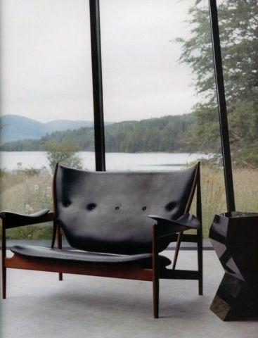 a Double Chieftain Chair designed by Finn Juhl