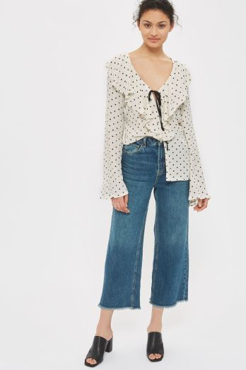 This dot top comes in Topshop Tall, Petite, and regular.