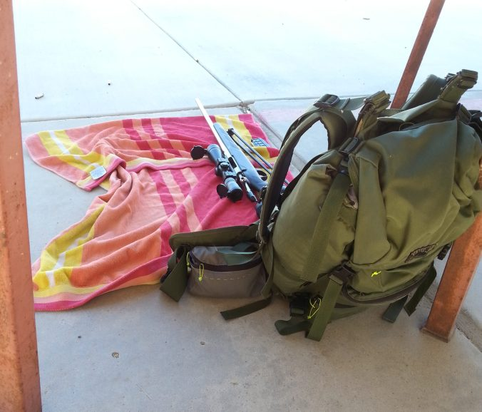 I'm allowed to shoot from the ground at my outdoor range. I bring my backpack, as that's what I'll be wearing when hunting in the wilderness. A towel to sit on is also nice.