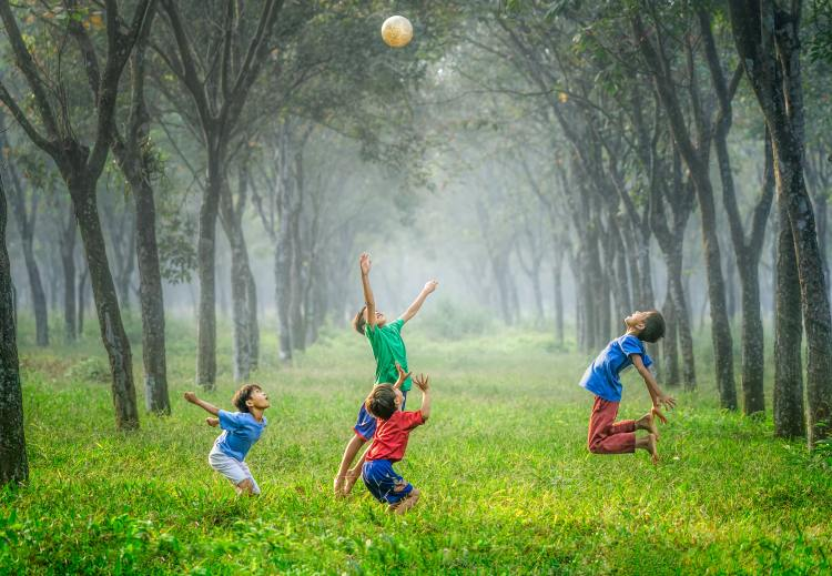 Public health ethics call for kids playing outside.