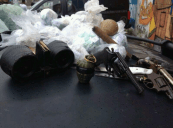 Guns, bullets, binoculars and grenades