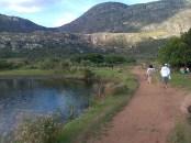 A red-dirt path runs across a little bridge in Lapinha da Serra