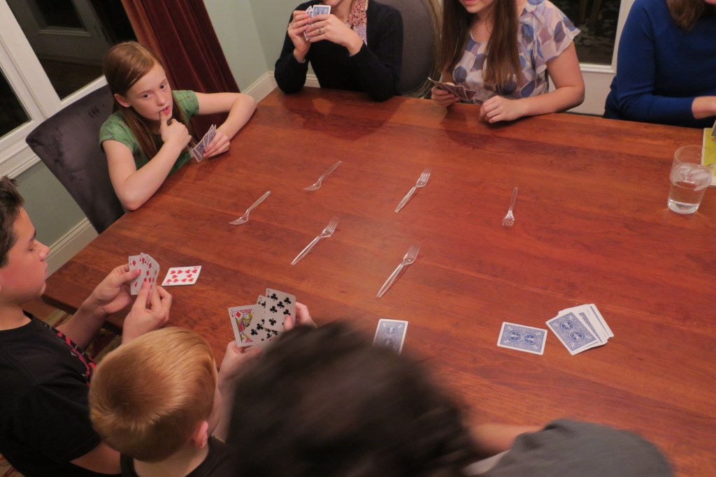 """An intense game of """"spoons"""" well technically """"forks'. :)"""