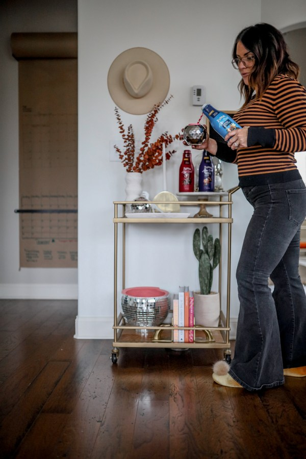Evening Routine featured by top US lifestyle blog Modern Day Moguls; image of a woman pouring a glass of milk.
