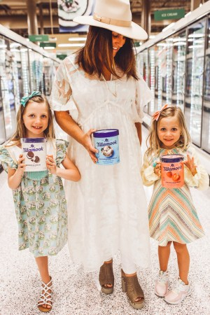 How to Throw a Fun and Easy Summer Soiree by popular Nashville blog Modern Day Moguls: image of mom and two young girls holding cartons of Tillamook ice cream in the frozen food aisle at Publix grocery store.