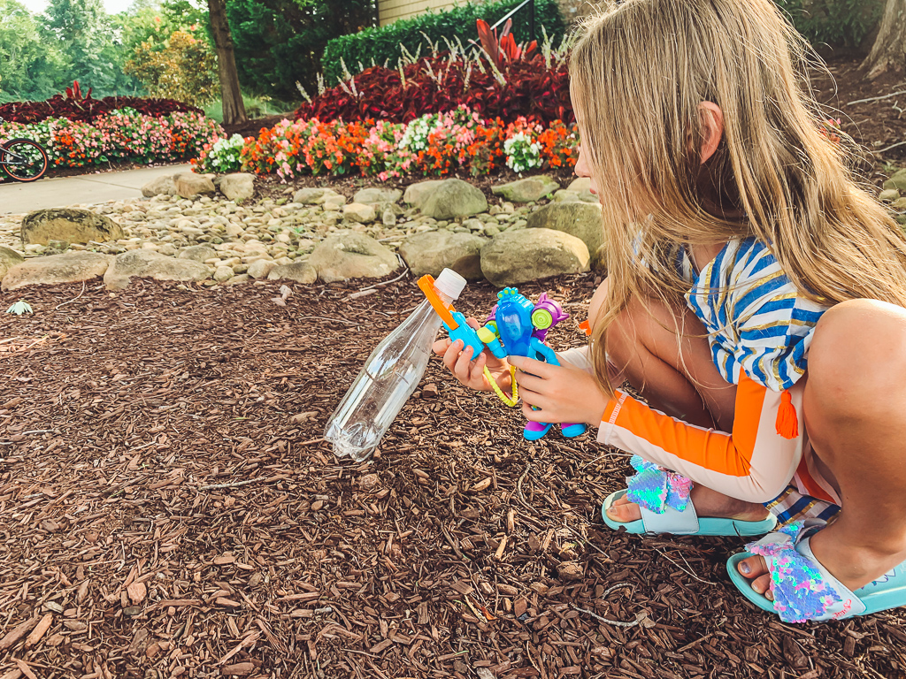 Rescue Heroes Toys: Play Time That Could Teach All Of Us Something by popular life and style blog, Modern Day Moguls:  image of a little girl playing with Rescue Heroes toys in a garden.