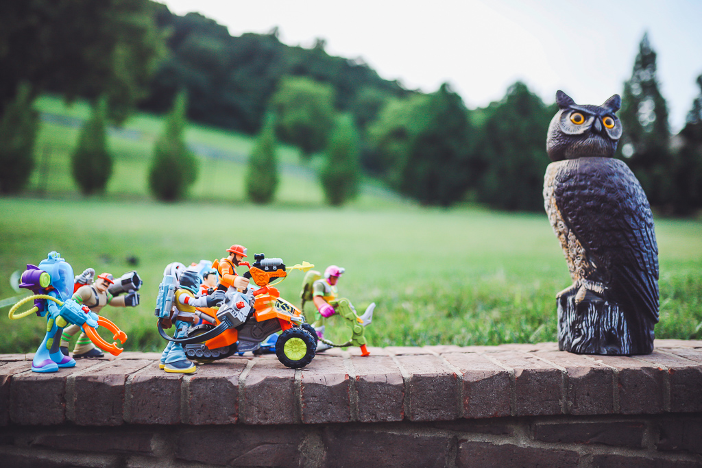 Rescue Heroes Toys: Play Time That Could Teach All Of Us Something by popular life and style blog, Modern Day Moguls:  image of Rescue Heroes toys lined up on a brick wall.