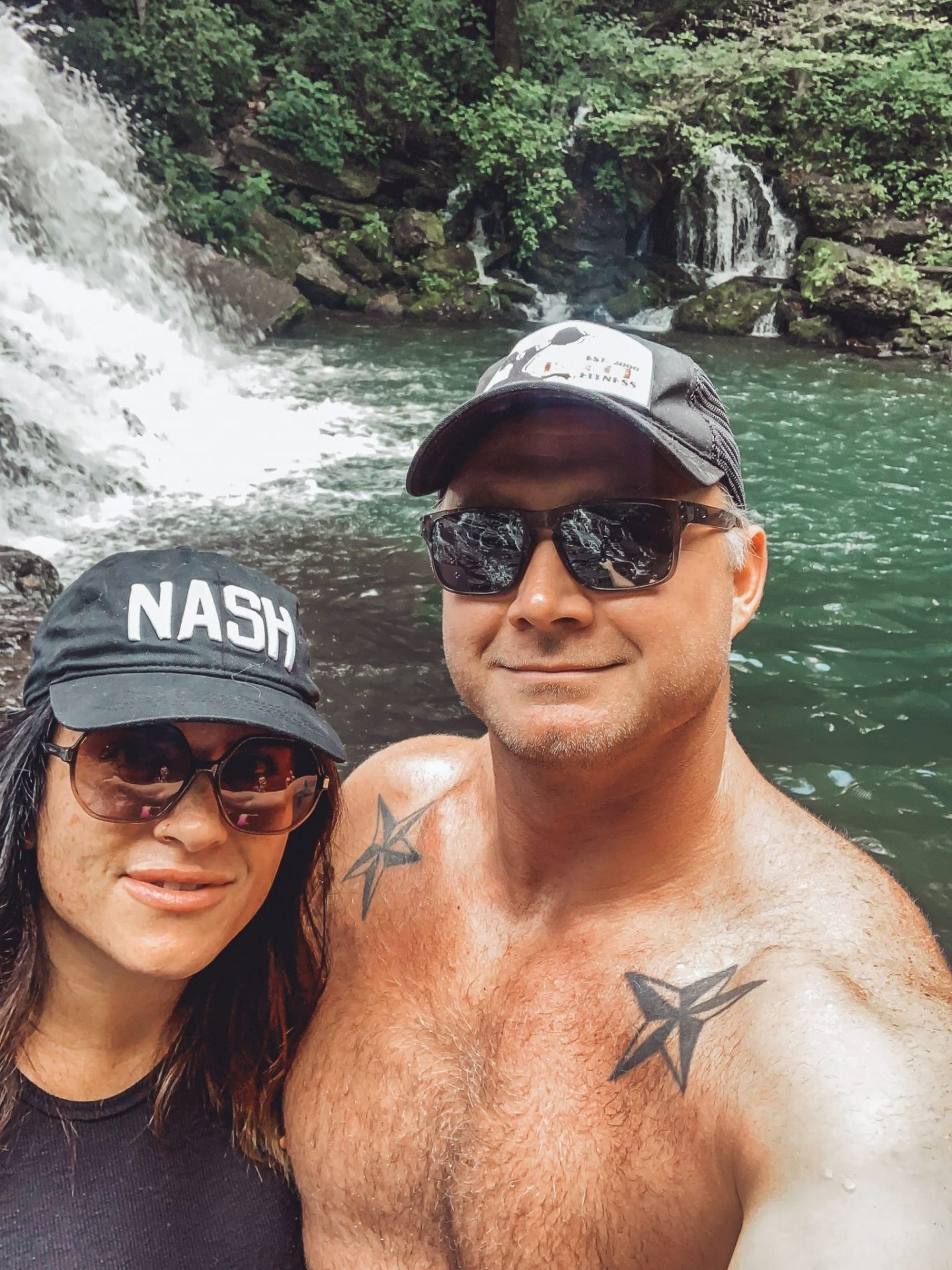Family-Friendly Waterfall Hiking Trails in Nashville, TN by popular Nashville blog, Modern Day Moguls: image of a man and woman taking a selfie next to Rutledge Falls in Tullahoma, TN.