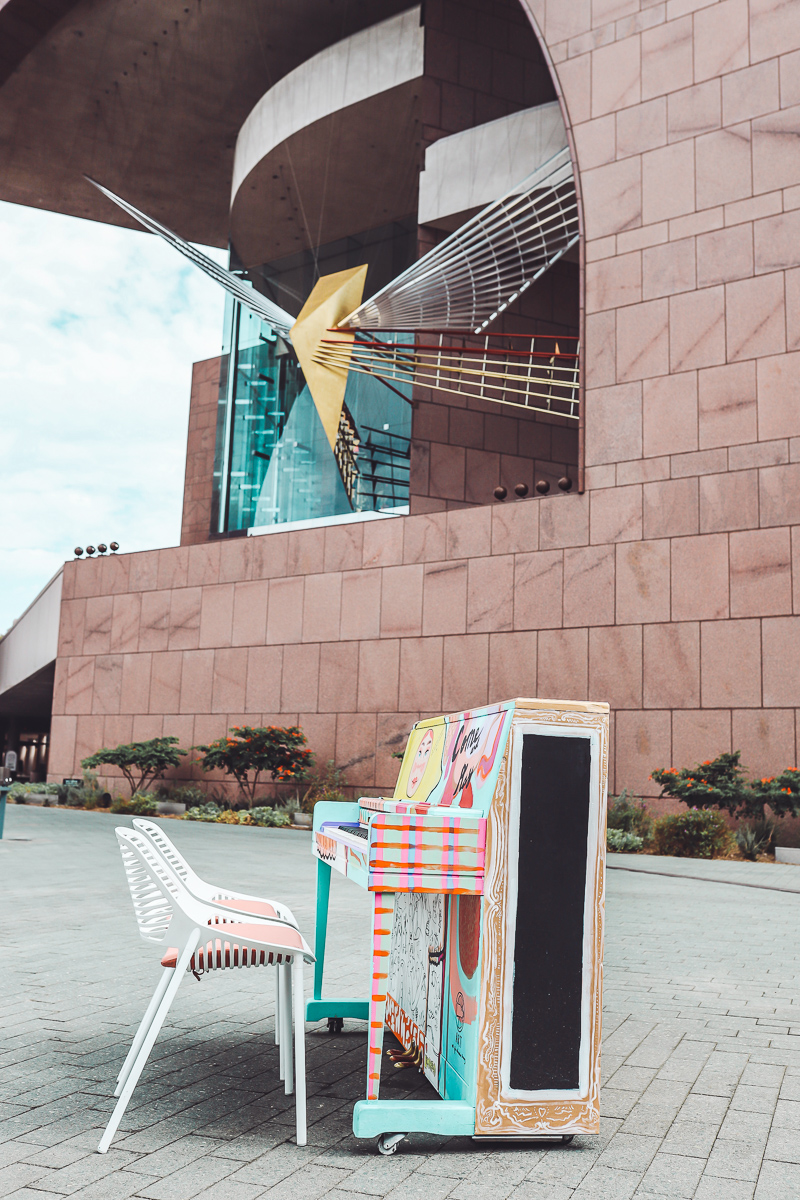 California Vacation Ideas for a Momcation in Orange County by popular Nashville travel blog, Modern Day Moguls: image of a painted piano outside.