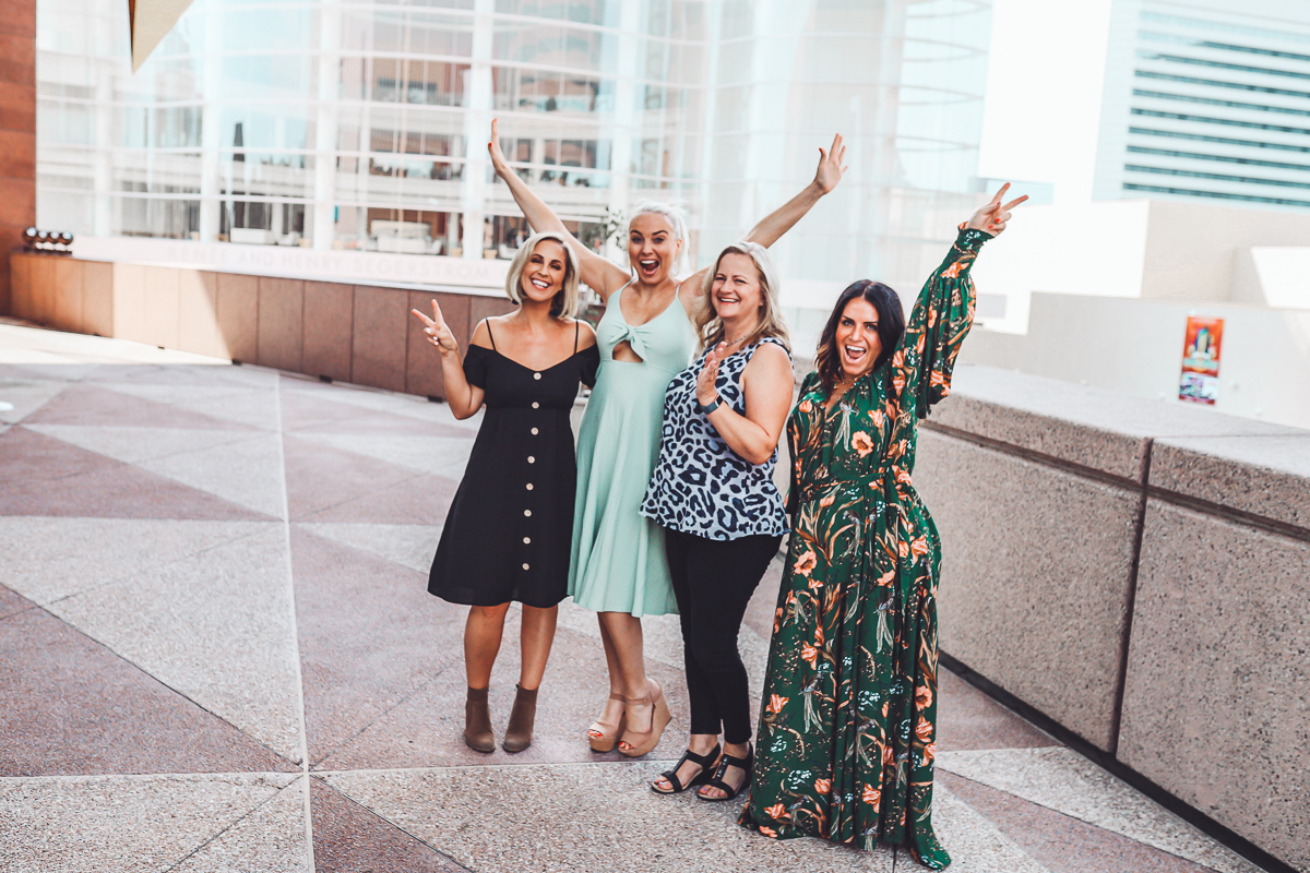 California Vacation Ideas for a Momcation in Orange County by popular Nashville travel blog, Modern Day Moguls: image of four women standing together outside.
