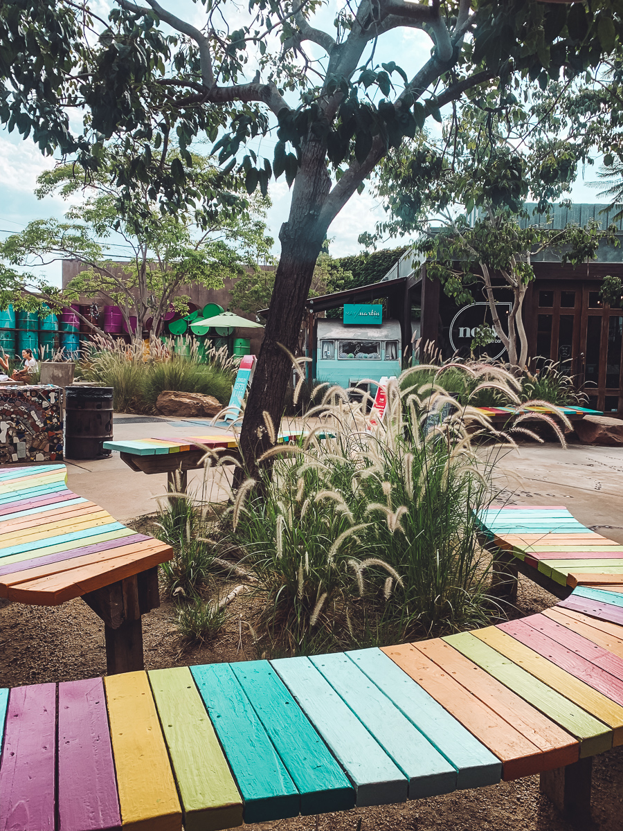 California Vacation Ideas for a Momcation in Orange County by popular Nashville travel blog, Modern Day Moguls: image of a rain sitting bench.