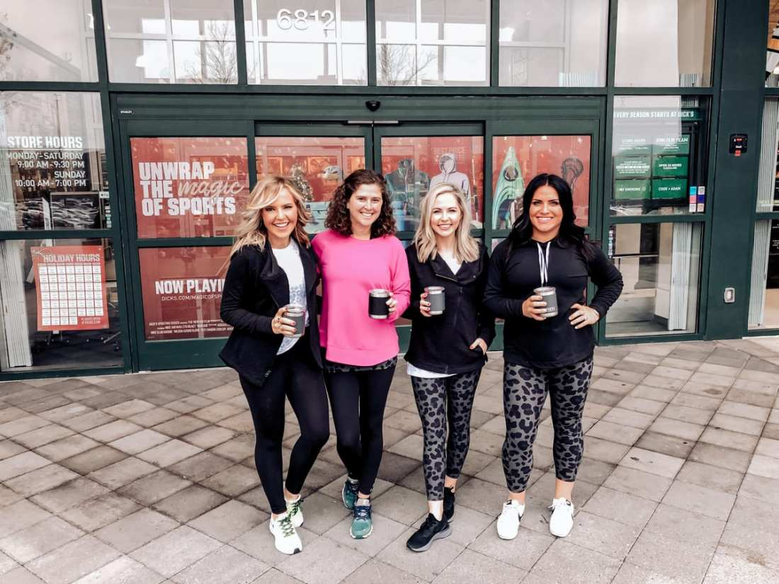 Unwrap the Magic of Sports with Dick's Gift Ideas by popular Nashville life and style blog, Modern Day Moguls: image of four Nashville bloggers standing outside Dick's Sporting Goods Store with Yeti mugs.