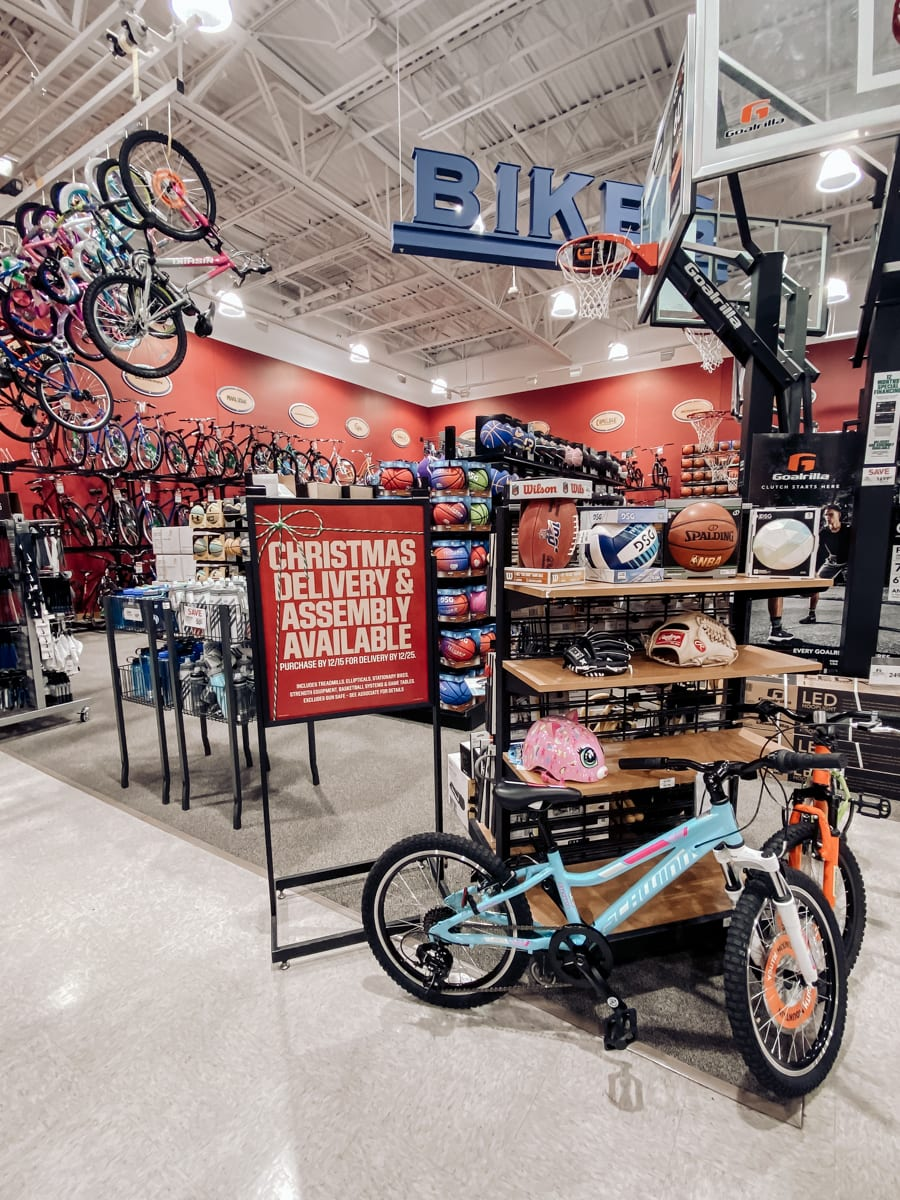 Unwrap the Magic of Sports with Dick's Gift Ideas by popular Nashville life and style blog, Modern Day Moguls: image of Schwinn bike and Spalding basketball.