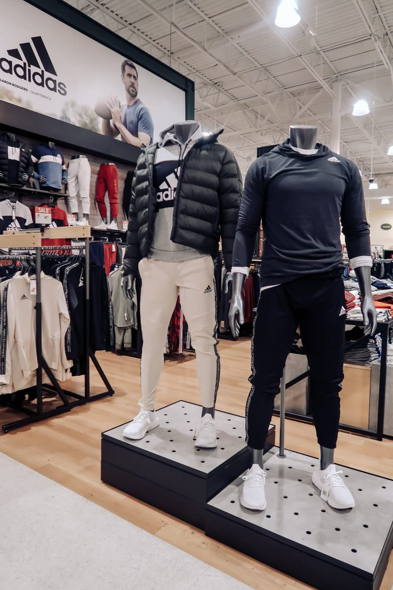 Unwrap the Magic of Sports with Dick's Gift Ideas by popular Nashville life and style blog, Modern Day Moguls: image of Nike Men's Sportswear ½ Zip Fleece Hoodie and adidas Men's Tiro 19 Tape Training Pants.