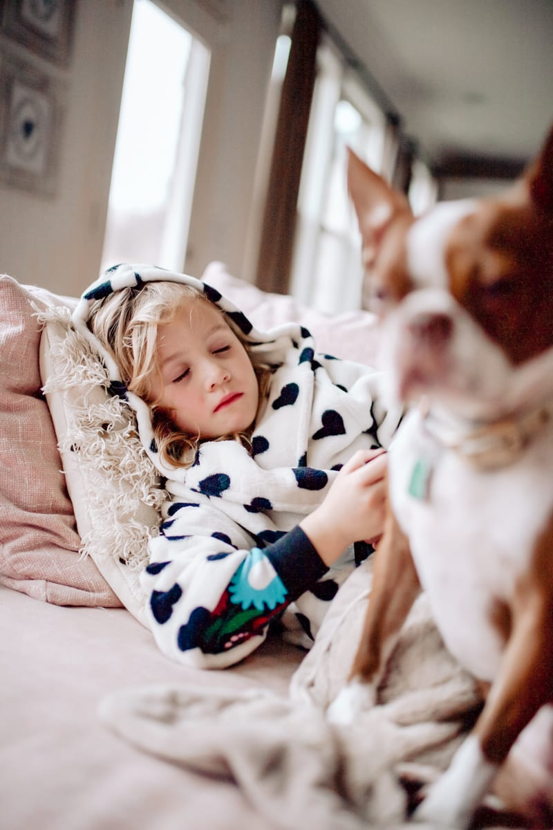 Acetaminophen for Flu by popular Nashville lifestyle blog, Modern Day Moguls: image of a little girl sleeping on a couch.