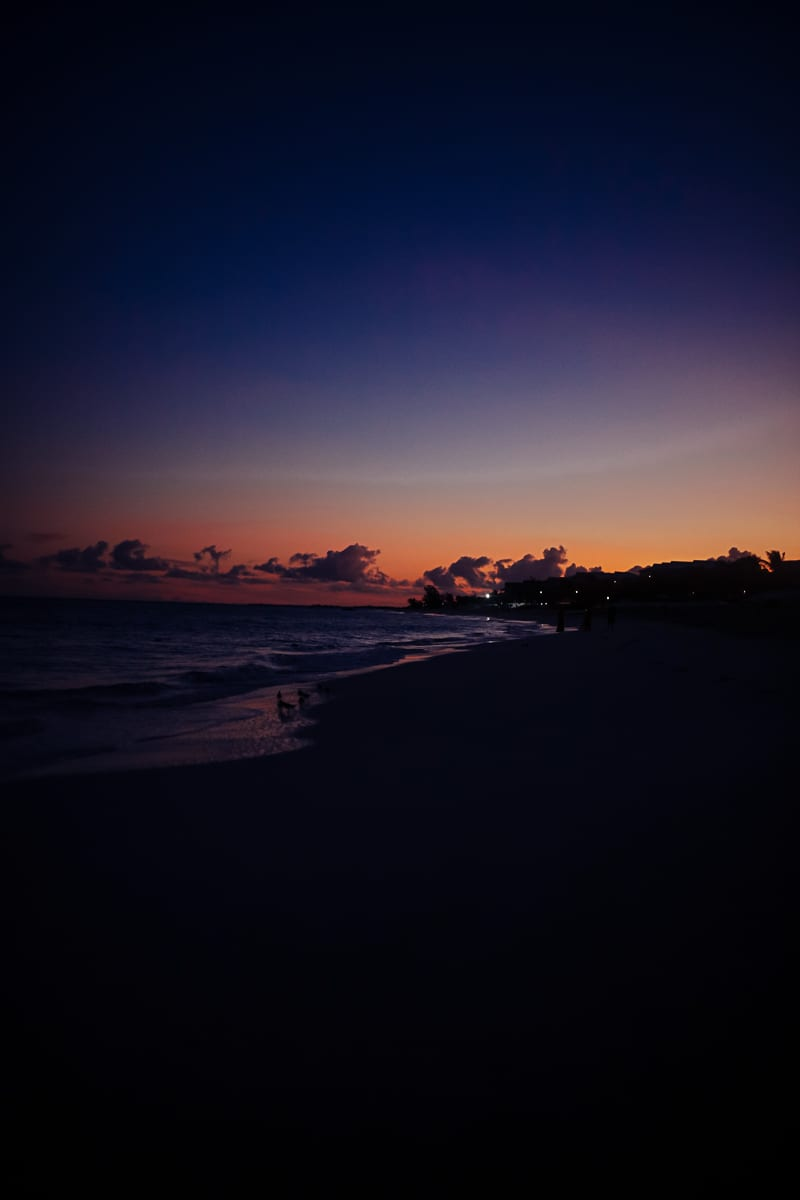 Visiting Turks and Caicos with Kids by popular Nashville travel blog, Modern Day Moguls: image of a sunset in Turks and Caicos.