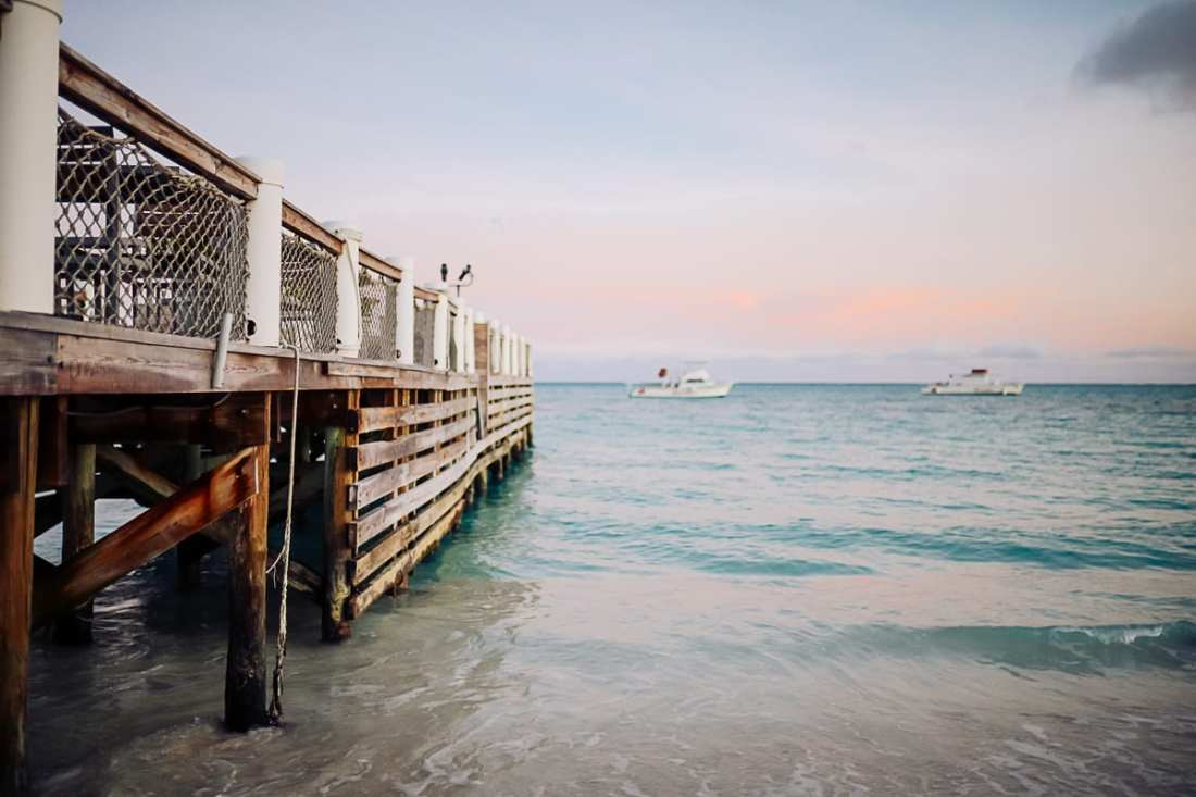 Visiting Turks and Caicos with Kids by popular Nashville travel blog, Modern Day Moguls: image of a boat dock in Turks and Caicos.
