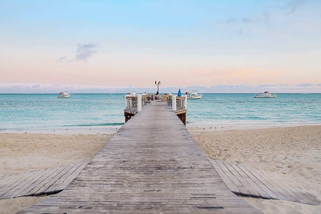 Visiting Turks and Caicos with Kids by popular Nashville travel blog, Modern Day Moguls: image of a pier in Turks and Caicos.