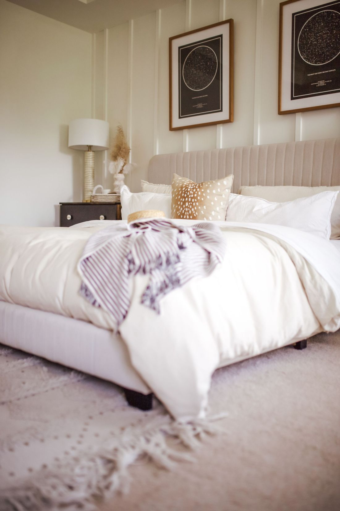 master bedroom refresh | Master Bedroom Remodel Ideas by popular Nashville life and style blog, Modern Day Moguls: image of a master bedroom with a velvet bed frame, white bedding and a antelope print throw pillow.