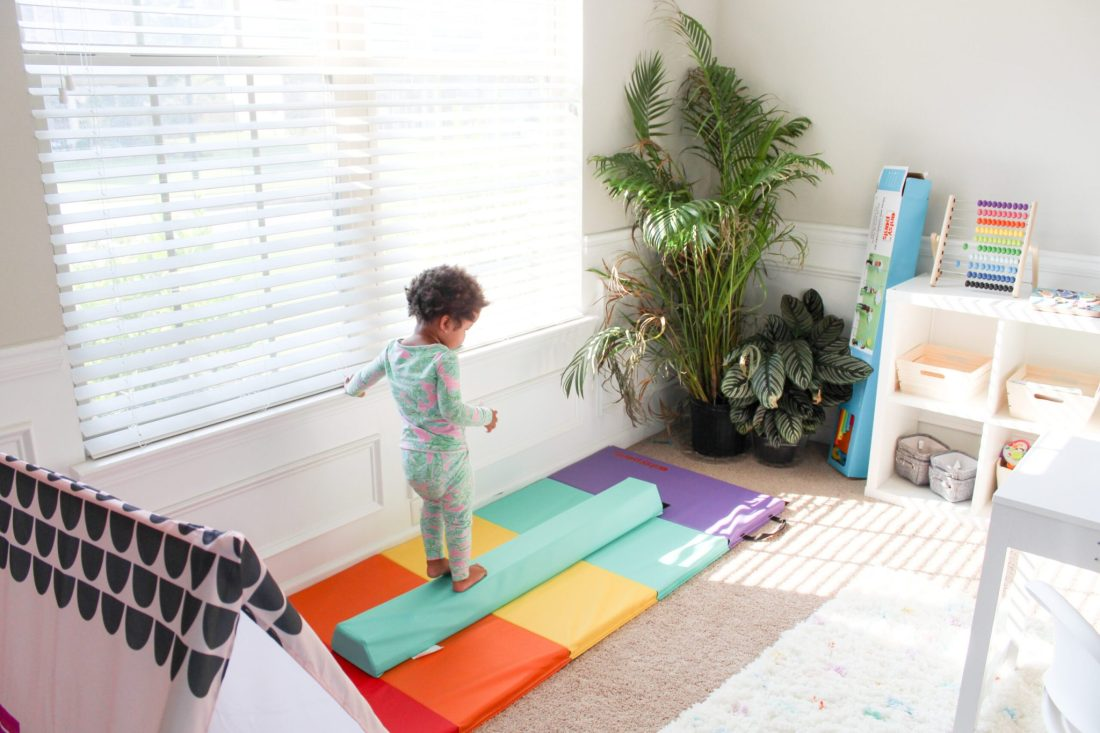 Homeshcool Room by popular Nashville life and style blog, Modern Day Moguls: image of a homeschool room with a tumbling mat and balance beam.