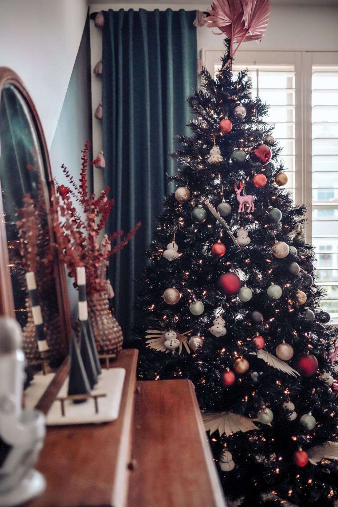 Carpet and Rug Institute by popular Nashville life and style blog, Modern Day Moguls: image of a home office decorated with a wooden dresser and black Christmas tree.